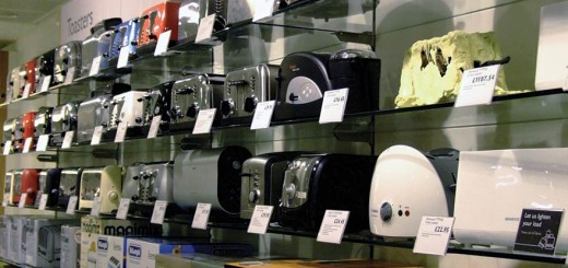 a homemade toaster on the shelf next to consumer toasters